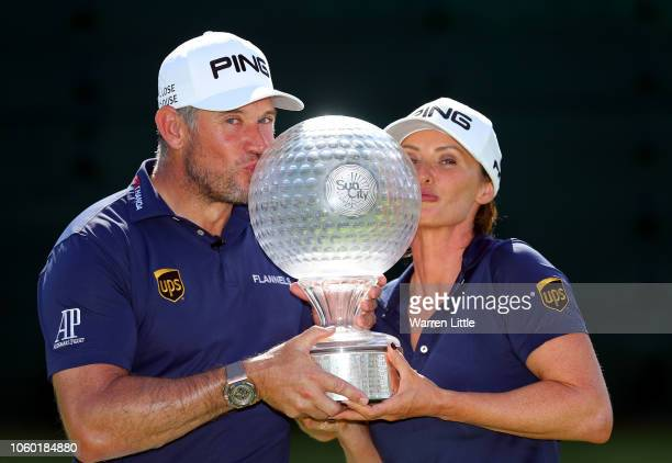 Lee Westwood of England poses with the trophy with partner and caddie, Helen Storey after winning the Nedbank Golf Challenge at Gary Player CC on...