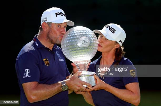 Lee Westwood of England poses with the trophy with partner and caddie Helen Storey after winning the Nedbank Golf Challenge at Gary Player CC on...
