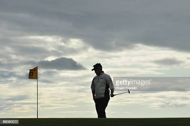Lee Westwood of England reacts to a putt on the 13th green during round two of the 138th Open Championship on the Ailsa Course Turnberry Golf Club on...