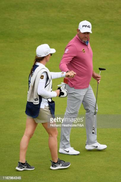 Lee Westwood of England reacts with his caddie and girlfriend Helen Storey after a birdie on the 13th hole during the second round of the 148th Open...