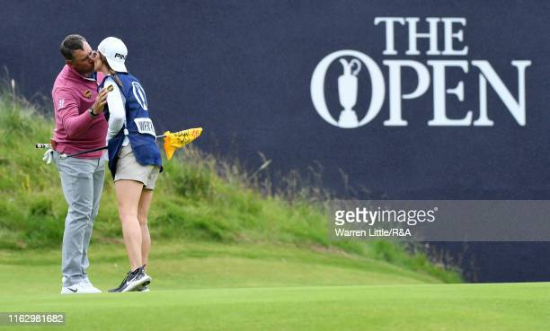 Lee Westwood of England reacts with his caddie and girlfriend Helen Storey on the 18th hole after completing the second round of the 148th Open...