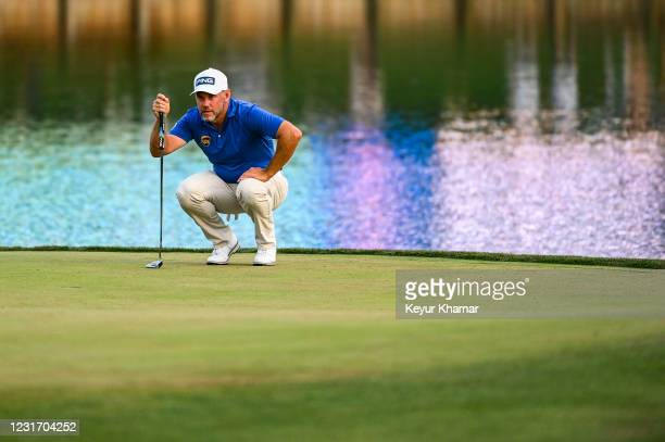 Lee Westwood of England reads his putt on the 17th hole green during the third round of THE PLAYERS Championship on the Stadium Course at TPC...