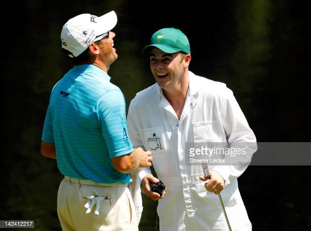 Lee Westwood of England shares a laugh with Anthony McPartlin of the duo Ant and Dec during the Par 3 Contest prior the 2012 Masters Tournament at...