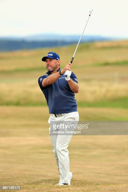 Lee Westwood of England takes his second shot on hole eighteen during day one of the Aberdeen Standard Investments Scottish Open at Gullane Golf...