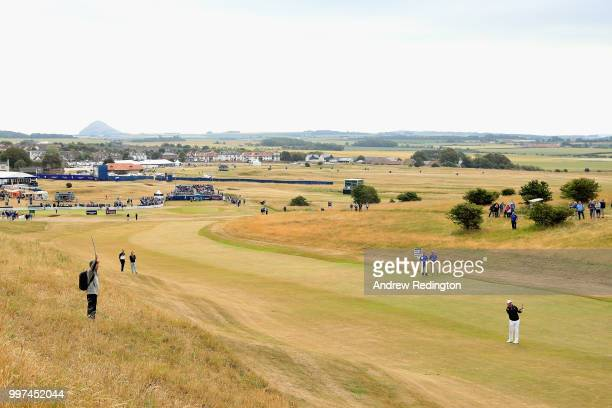 Lee Westwood of England takes his second shot on hole one during day two of the Aberdeen Standard Investments Scottish Open at Gullane Golf Course on...