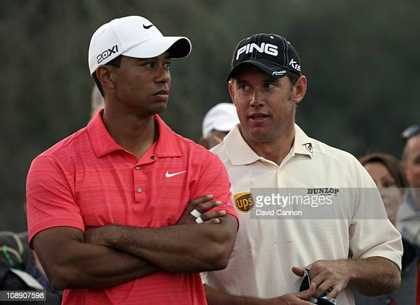 Lee Westwood of England the World's No 1 eyes Tiger Woods of the USA during the Challenge Match for the 2011 Omega Dubai Desert Classic to be held on...