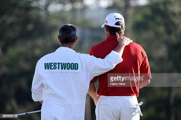 Lee Westwood of England waits with his caddie Billy Foster on the 18th green during the 2010 Masters Tournament at Augusta National Golf Club on...