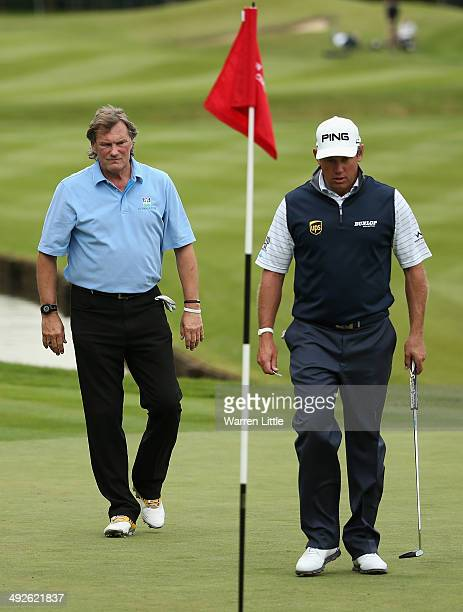 Lee Westwood of England walks across the 18th green with Glenn Hoddle during the ProAm ahead of the BMW PGA Championship at Wentworth on May 21 2014...