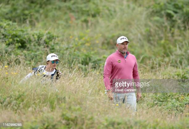Lee Westwood of England walks to the green with his caddie Helen Storey on the 13th hole during the second round of the 148th Open Championship held...