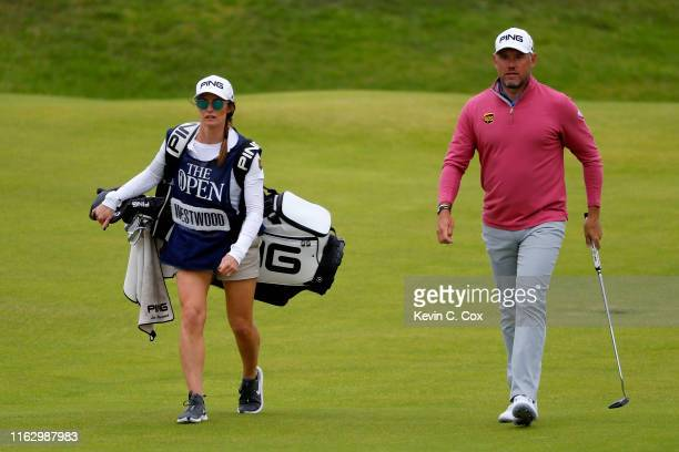 Lee Westwood of England walks with his caddie Helen Storey on the 18th hole during the second round of the 148th Open Championship held on the...