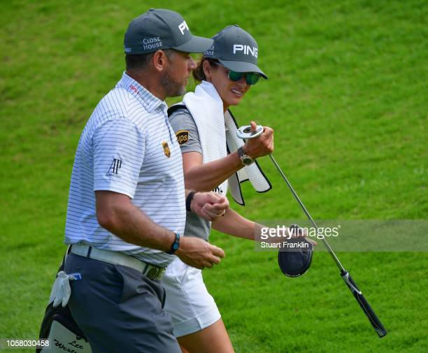Lee Westwood of England walks with his girlfriend Helen Story during the pro am prior to the start of the Nedbank Golf Challenge at Gary Player CC on...