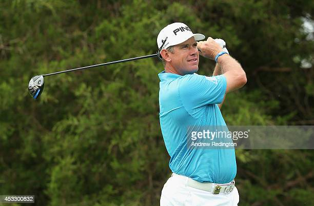 Lee Westwood of England watches his tee shot on the 18th hole during the first round of the 96th PGA Championship at Valhalla Golf Club on August 7...
