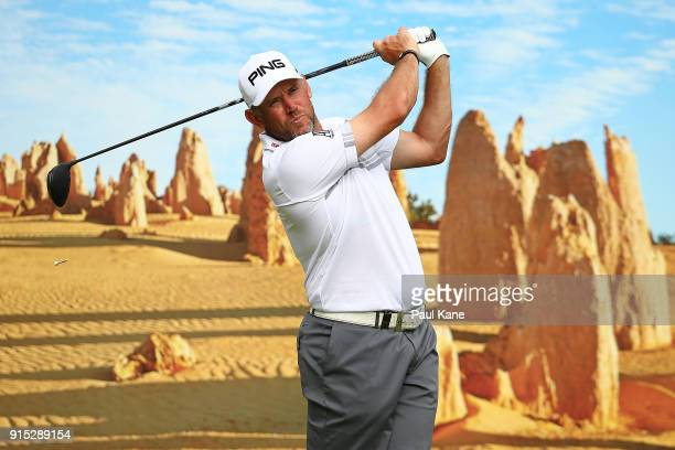 Lee Westwood of England watches his tee shot on the 6th hole during the pro-am ahead of the World Super 6 at Lake Karrinyup Country Club on February...