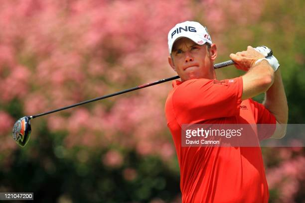 Lee Westwood of England watches his tee shot on the second hole during the third round of the 93rd PGA Championship at the Atlanta Athletic Club on...