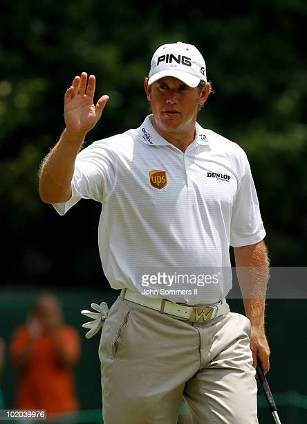 Lee Westwood of England waves to the crowd after making birdie putt on the second hole during the final round of the St Jude Classic at TPC Southwind...