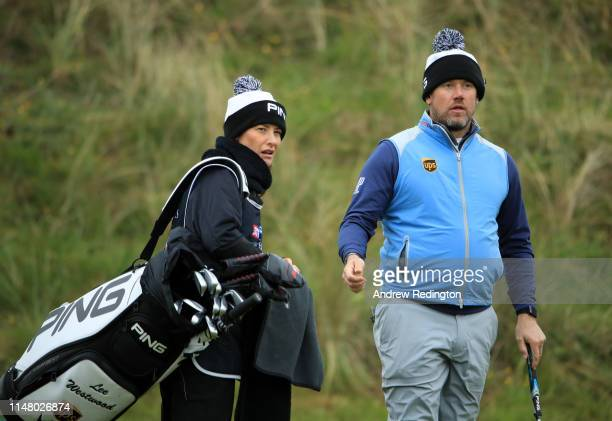 Lee Westwood of England with his Girlfriend and Caddy Helen Storey look on from the 17th during Day One of the Betfred British Masters at Hillside...