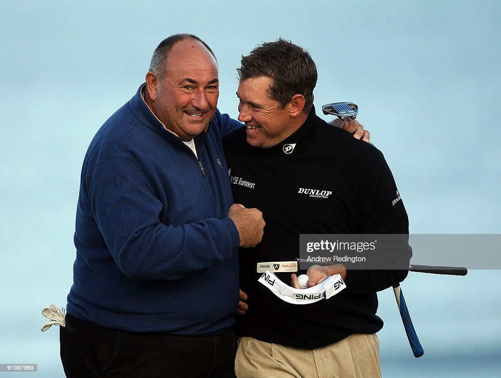 Lee Westwood of England with his playing a partner Andrew 'Chubby' Chandler on the 18th green during the third round of The Alfred Dunhill Links Championship at Kingsbarns Golf Links on October 4, 2009 in Kingsbarns, Scotland.The third round was postponed on Saturday due to gale force winds.