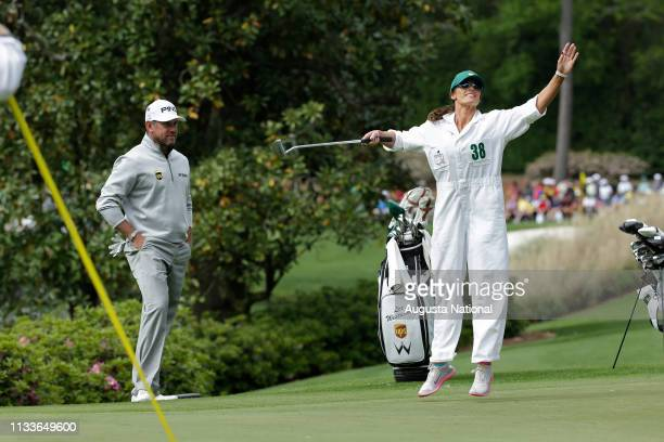 Lee Westwood of England's caddie celebrates a putt on No. 5 during the Par 3 Contest at the 2016 Masters Tournament on Wednesday, April 6, 2016.