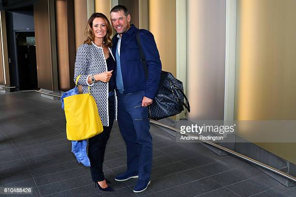 Lee Westwood of Europe and his girlfriend Helen Storey pose before departing Heathrow Airport Terminal 5 ahead of the 2016 Ryder Cup on September 26...