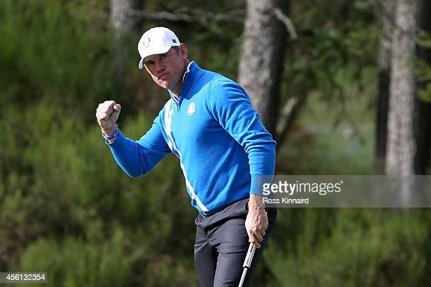 Lee Westwood of Europe celebrates a birdie on the 6th green during the Afternoon Foursomes of the 2014 Ryder Cup on the PGA Centenary course at the...
