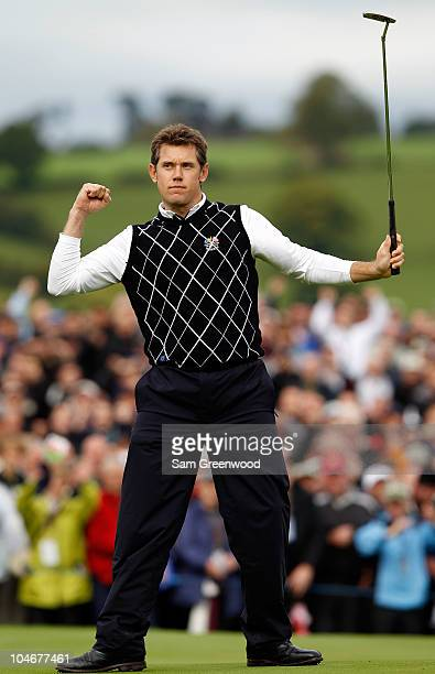 Lee Westwood of Europe celebrates holing a putt on the 10th green during the Fourball & Foursome Matches during the 2010 Ryder Cup at the Celtic...