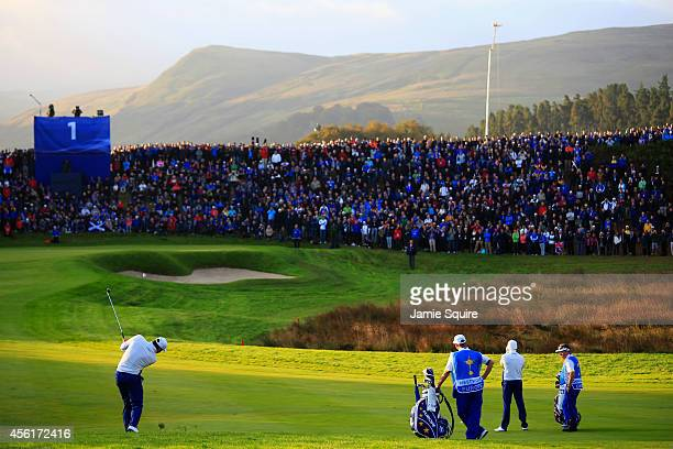 Lee Westwood of Europe hits his approach to the 1st green during the Morning Fourballs of the 2014 Ryder Cup on the PGA Centenary course at the...