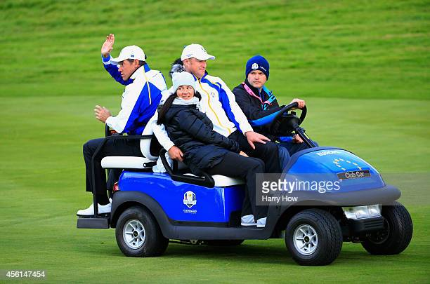 Lee Westwood of Europe Jamie Donaldson of Europe and his partner Kathryn Tagg ride on a buggy during the Afternoon Foursomes of the 2014 Ryder Cup on...