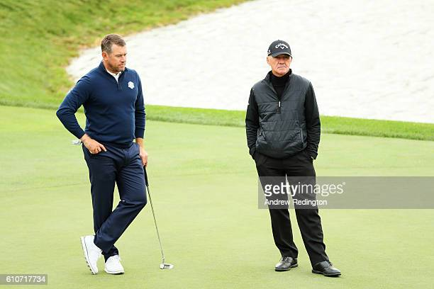 Lee Westwood of Europe looks on with coach Pete Cowen during practice prior to the 2016 Ryder Cup at Hazeltine National Golf Club on September 27...