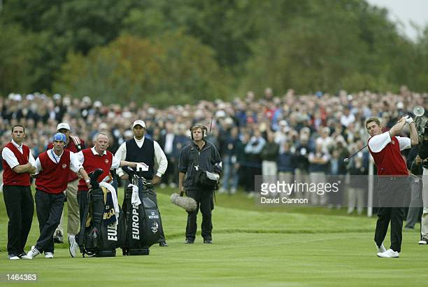 Lee Westwood of Europe plays his second shot to the 17th green during the afternoon foursomes on the first day of the 34th Ryder Cup matches between...