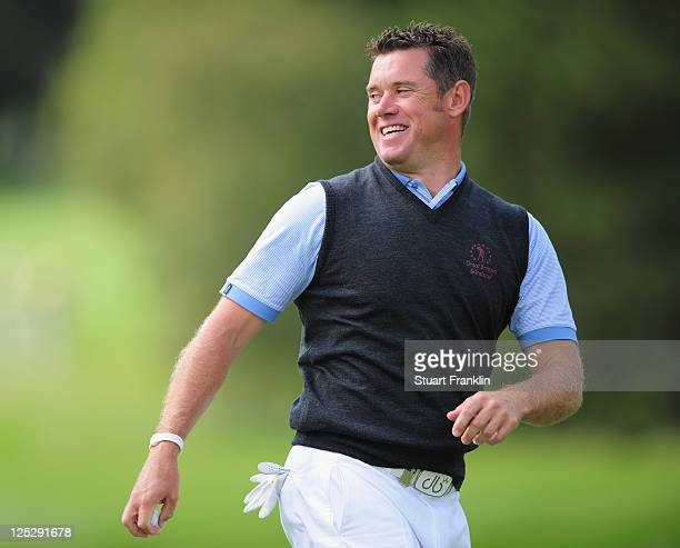 Lee Westwood of the Great Britian and Ireland team looks happy during the second days fourball matches at the Vivendi Seve Trophy at Saint - Nom - La...