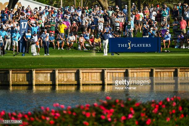 Lee Westwood plays his shot from the 17th tee during the final round of THE PLAYERS Championship on the Stadium Course at TPC Sawgrass on March 14 in...