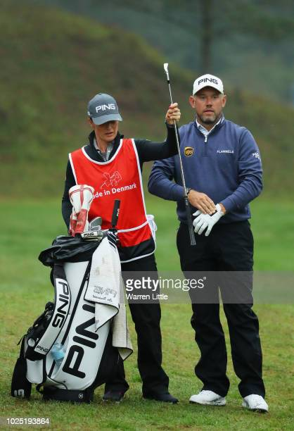Lee Westwood speakd to his caddy Helen Storey during day one of the Made in Denmark played at the Silkeborg Ry Golf Club on August 30 2018 in...