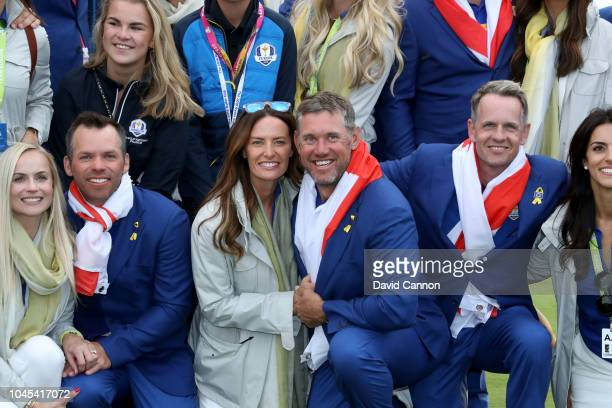Lee Westwood with his partner Helen Storey after their 175105 win over the United States during the singles matches of the 2018 Ryder Cup at Le Golf...
