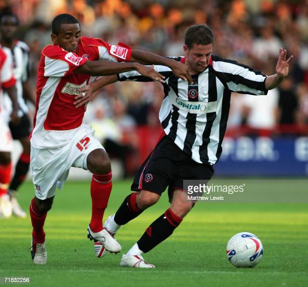 Lee Williamson of Rotherham and Chris Armstrong of Sheffield challenge for the ball during the Preseason Friendly match between Rotherham and...