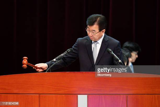 Lee Wonhee president and chief executive officer of Hyundai Motor Co hits a gavel during the annual shareholders meeting at the company's...