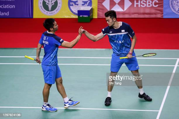 Lee Yang and Wang Chi-Lin of Chinese Taipei celebrate the victory in the Men's Doubles second round match against Jason Anthony Ho-Shue and Nyl...