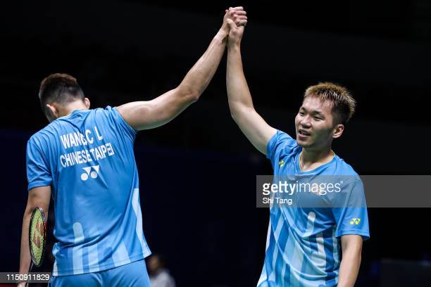 Lee Yang and Wang ChiLin of Chinese Taipei celebrate the victory after the Men's Doubles match against Choi Solgyu and Seo Seung Jae of Korea during...