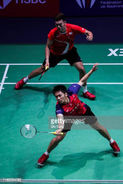 Lee Yang and Wang ChiLin of Chinese Taipei compete in the Men's Doubles second round match against Takeshi Kamura and Keigo Sonoda of Japan on day...