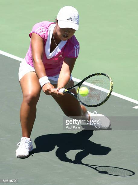 Lee YeRa of Korea plays a return shot to Samantha Stosur of Australia during the second game of the first round Fed Cup match between Australia and...