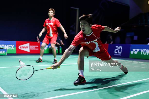 Lee Yong Dae and Kim Gi Jung of Korea compete in the Men's Doubles first round match against Lu Ching Yao and Yang Po Han of Chinese Taipei on day...