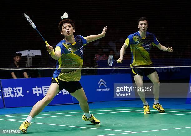 Lee Yong Dae and Yoo Yeon Seong of South Korea hit a return to Li Junhui and Liu Yuchen of China during their men's doubles final match at the 2016...