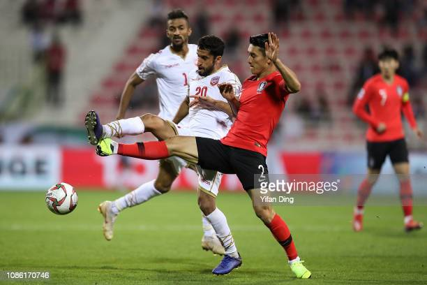 Lee Yong of South Korea and Sami Al Husaini of Bahrain in action during the AFC Asian Cup round of 16 match between South Korea and Bahrain at Rashid...