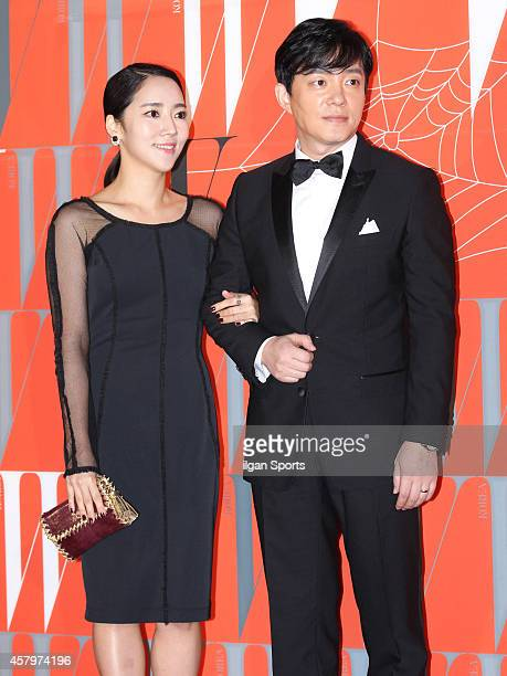 Lee YoonJin and Lee BeomSoo pose for photographs during the W Korea campaign Love Your W party at Fradia on October 23 2014 in Seoul South Korea