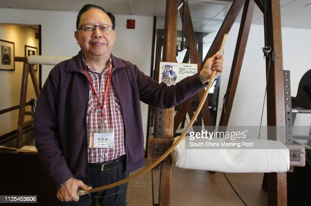 Lee Yuklun docent of Hong Kong Correctional Services Museum poses for a photo with a device for caning in the museum in Stanley 13DEC12