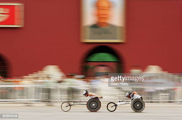 Lee YunOh of Korea and another competitor in the marathon make their way past the Forbidden City at Tiananmen Square during Day 11 of the 2008...
