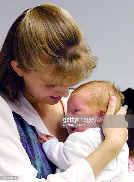 LeeAnn Green wife of polygamist Tom Green holds her new baby John Richard Bucher Green who was born 11 June and named after Tom Green's attorney just...