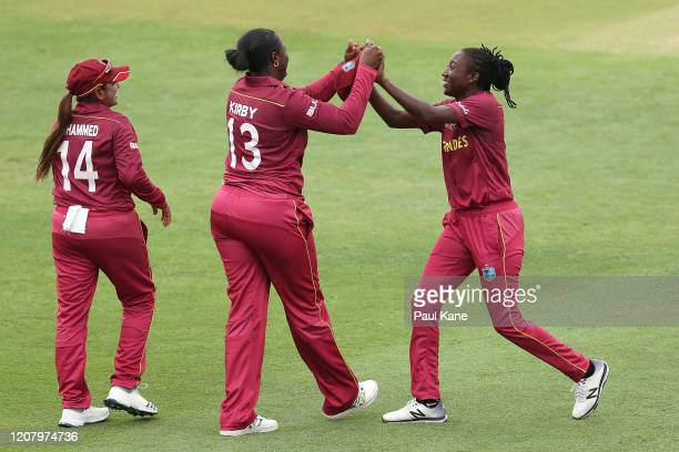 Leeann Kirby and Stafanie Taylor of the West Indies celebrate the wicket of Nannapat Khoncharoenkai of Thailand during the ICC Women's T20 Cricket...