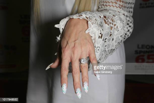 LeeAnn Welch ring nails detail shows off her engagement ring during a birthday celebration for Leon Spinks' at the Chocolate Lounge at Sugar Factory...