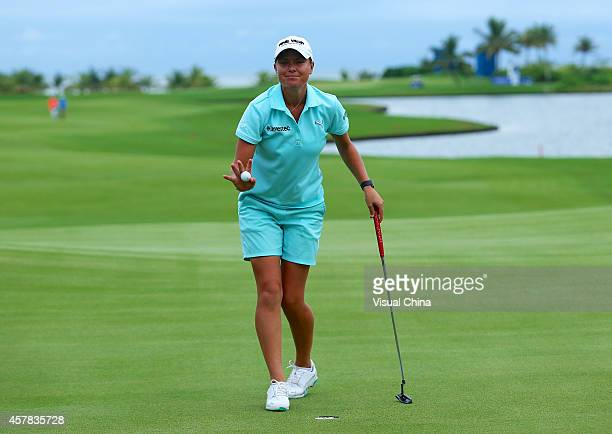 LeeAnne Pace of South pics up her ball during day three of the 2014 Blue Bay LPGA at Jian Lake Blue Bay Golf Course on October 25 2014 in Hainan...