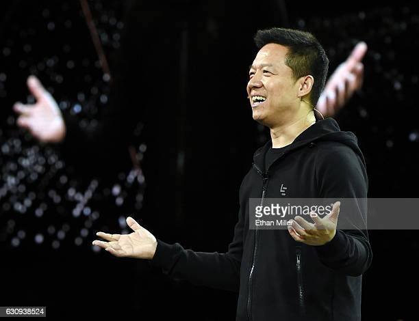 LeEco Founder and CEO YT Jia unveils Faraday Future's FF 91 prototype electric crossover vehicle during a press event for CES 2017 at The Pavilions...